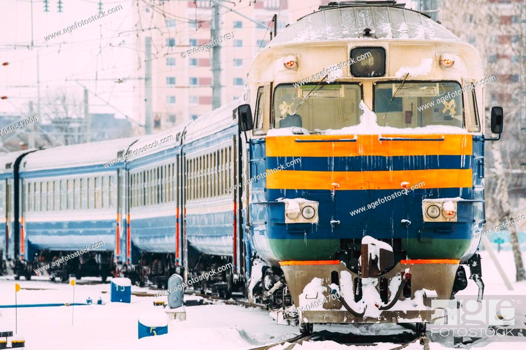 Stock Photo: Old Diesel locomotive on Railway In Cold Snowy Winter Day.