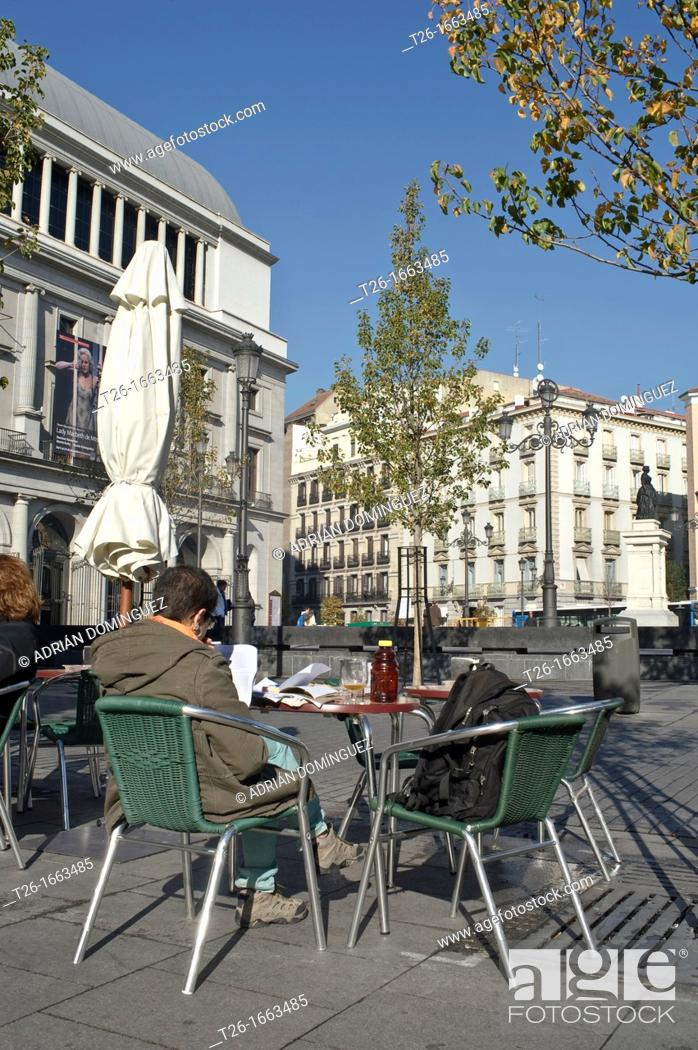 Stock Photo: Man sitting in a terrace in Opera square. Madrid, Spain.