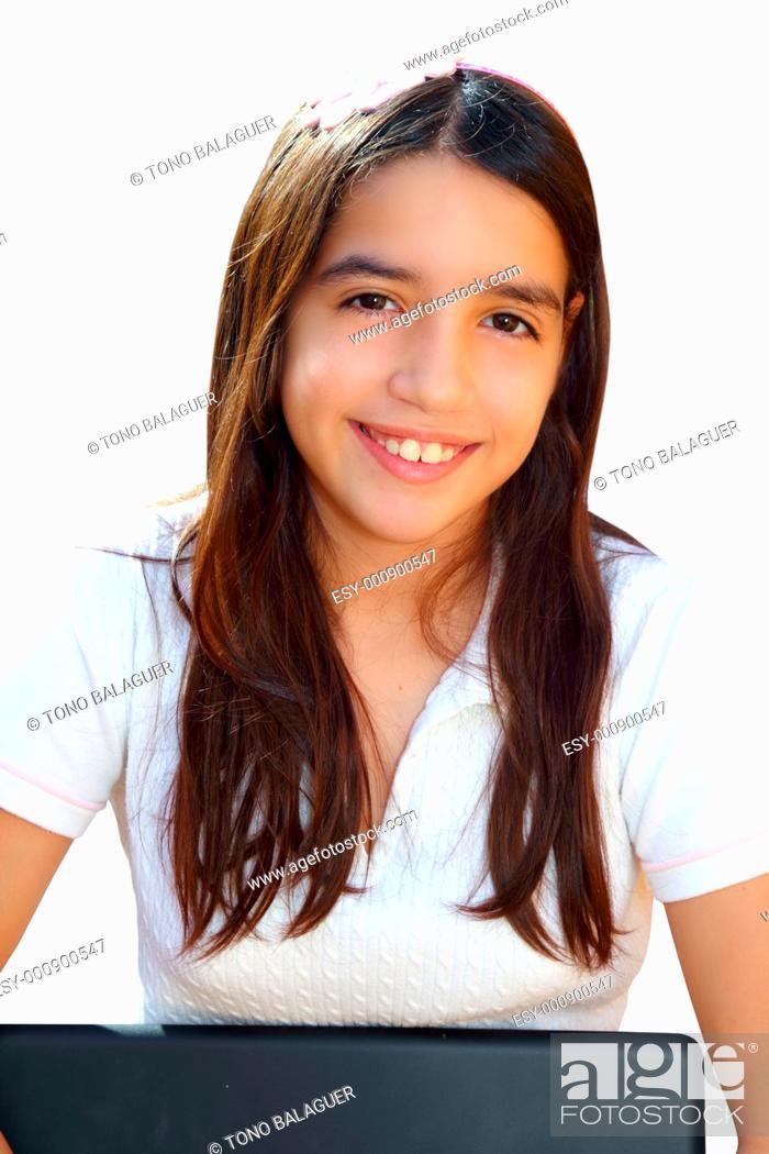Photo de stock: Latin teenager student smiling holding laptop isolated on white.