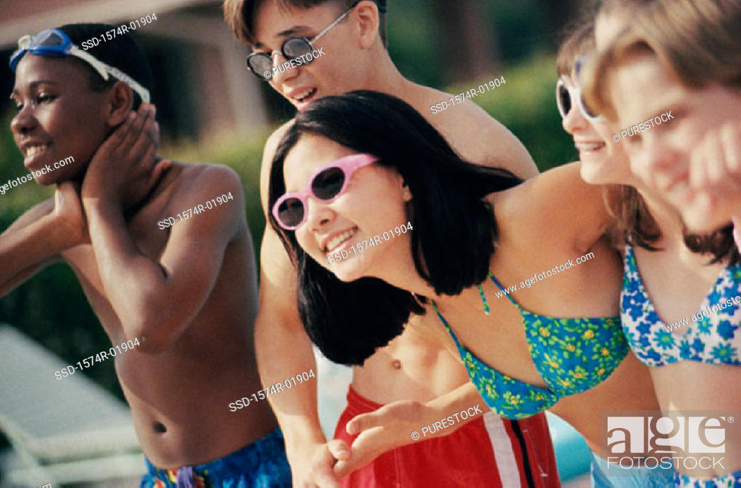 Stock Photo: Group of teenagers on the beach.