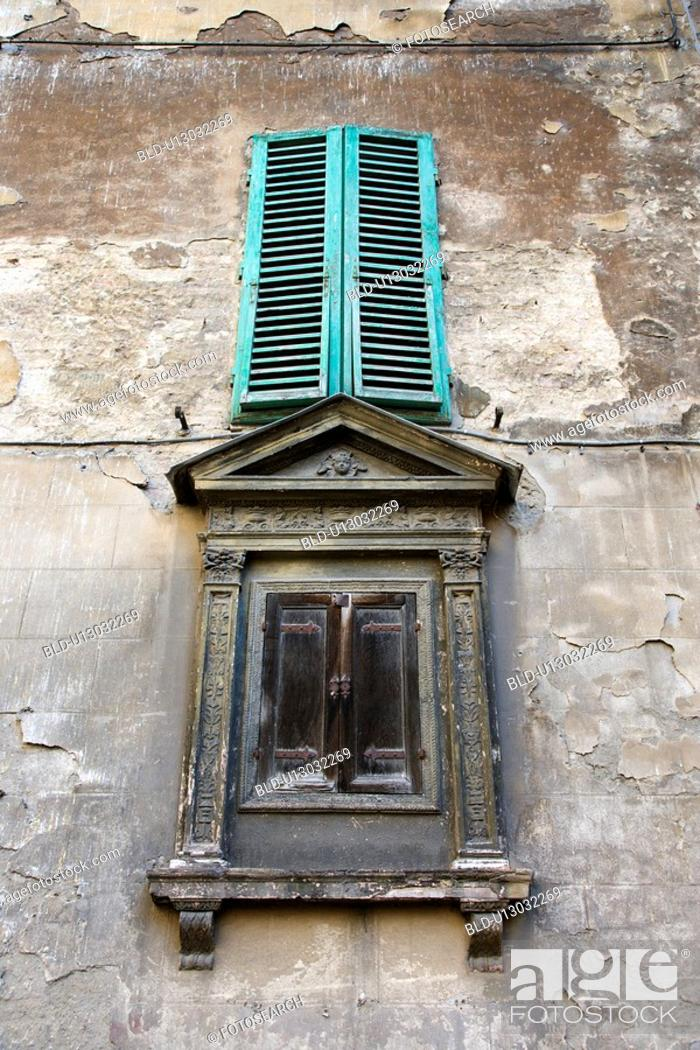 Stock Photo: Two shuttered windows in Italy.