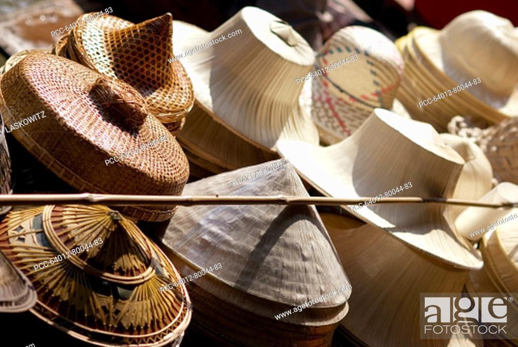 Stock Photo: Thailand, Bangkok, Damnoen Saduak Floating Market in Ratchaburi Province, traditional straw hats for sale.