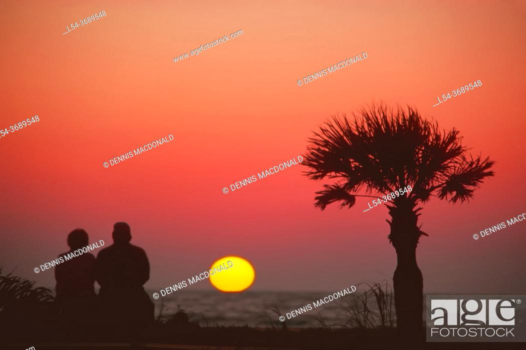 Stock Photo: . . senior couple view sunset together on Naples Beach, Florida.
