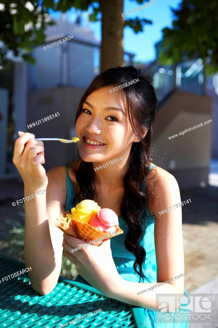 Stock Photo: Young Lady Eating Ice-Cream.