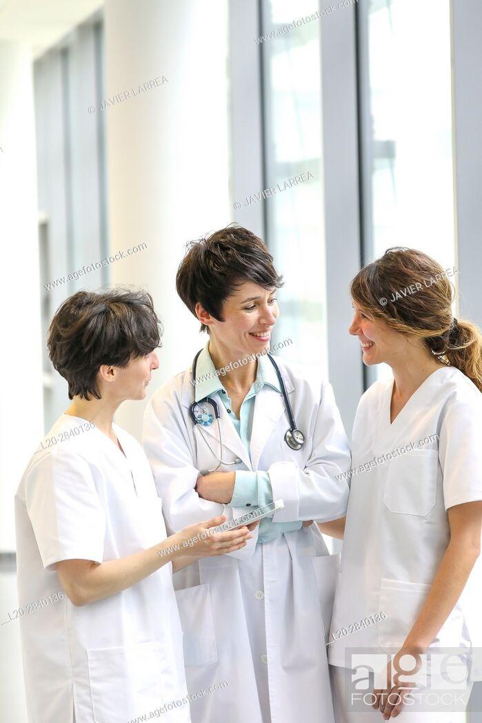Stock Photo: Doctors and nurses talking in corridor, Hospital.