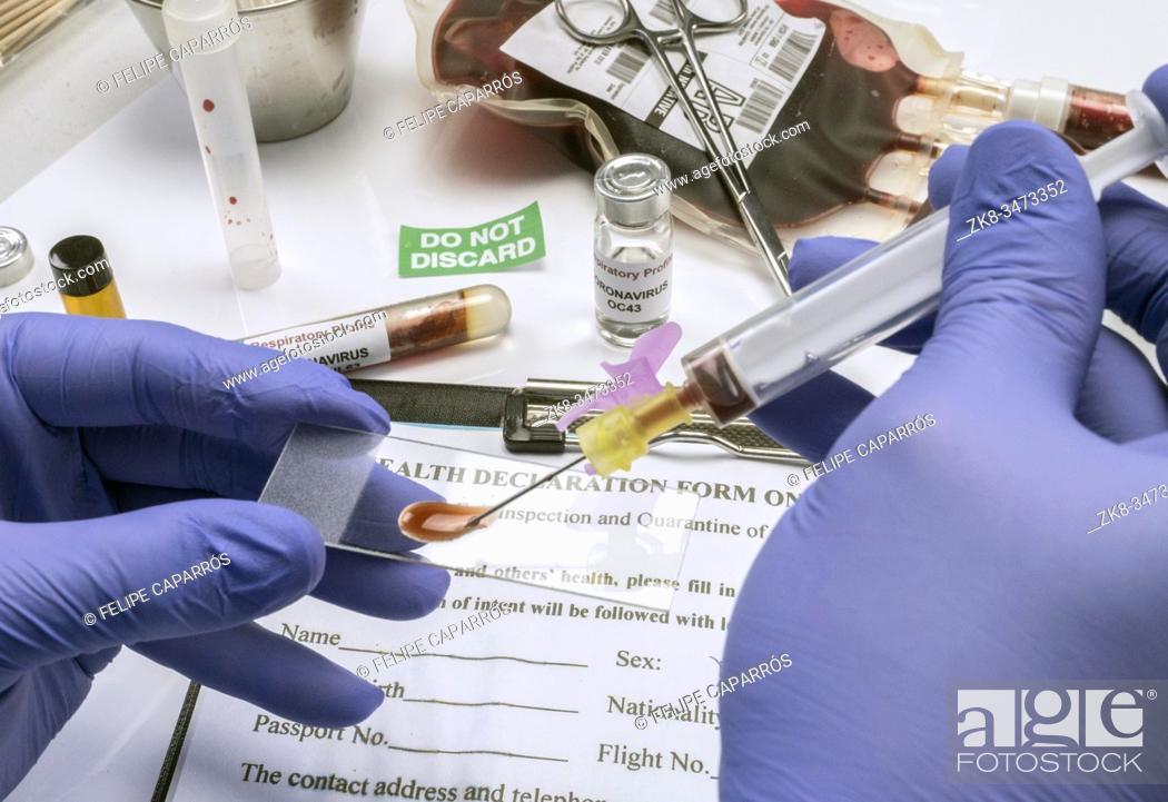 Stock Photo: Scientific examines sample of coronavirus.