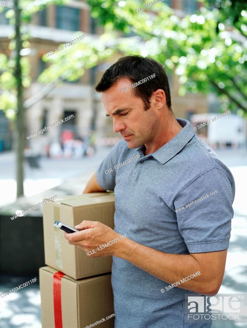 Stock Photo: A courier delivers parcels.
