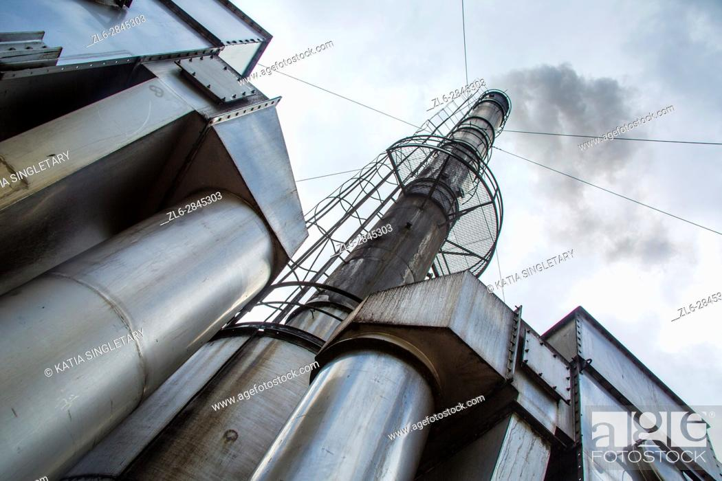 Stock Photo: Incredible drastic grey sky with a refinery and silo high in the sky .