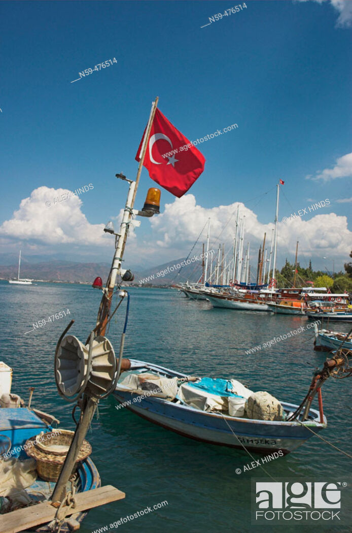 Stock Photo: Fishing boats and Turkish flag at Fethiye, Turkey.