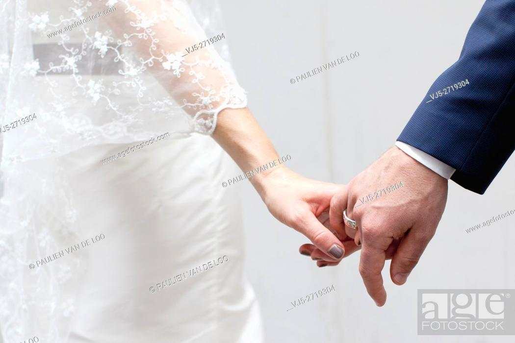 Stock Photo: Helmond, Netherlands, a couple that is getting married is holding hands. They trust eachother.