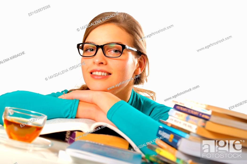 Stock Photo: Portrait of female student studying at the table.
