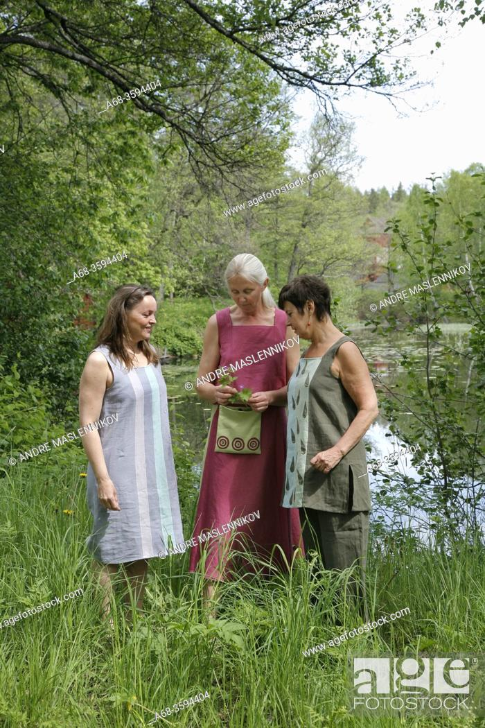 Stock Photo: Middle-aged women with clothes they sewed themselves. Model released. Sweden. Photo: André Maslennikov.