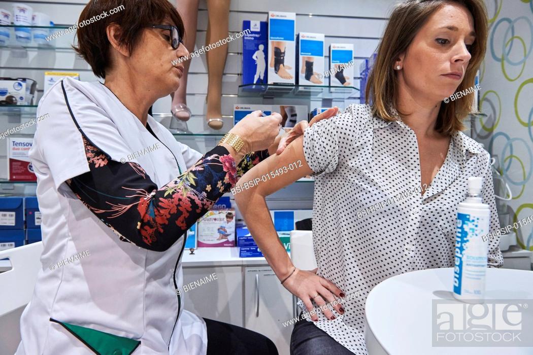 Stock Photo: Seasonal flu vaccination in a pharmacy.