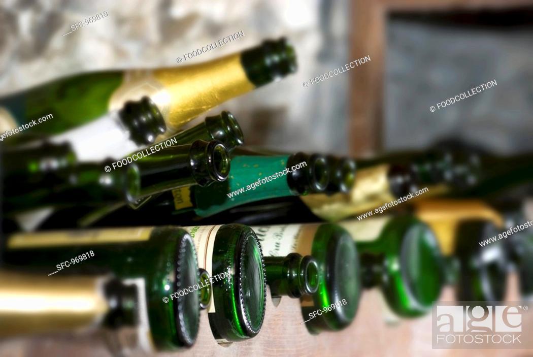 Stock Photo: Sparkling wine bottles in wine rack.