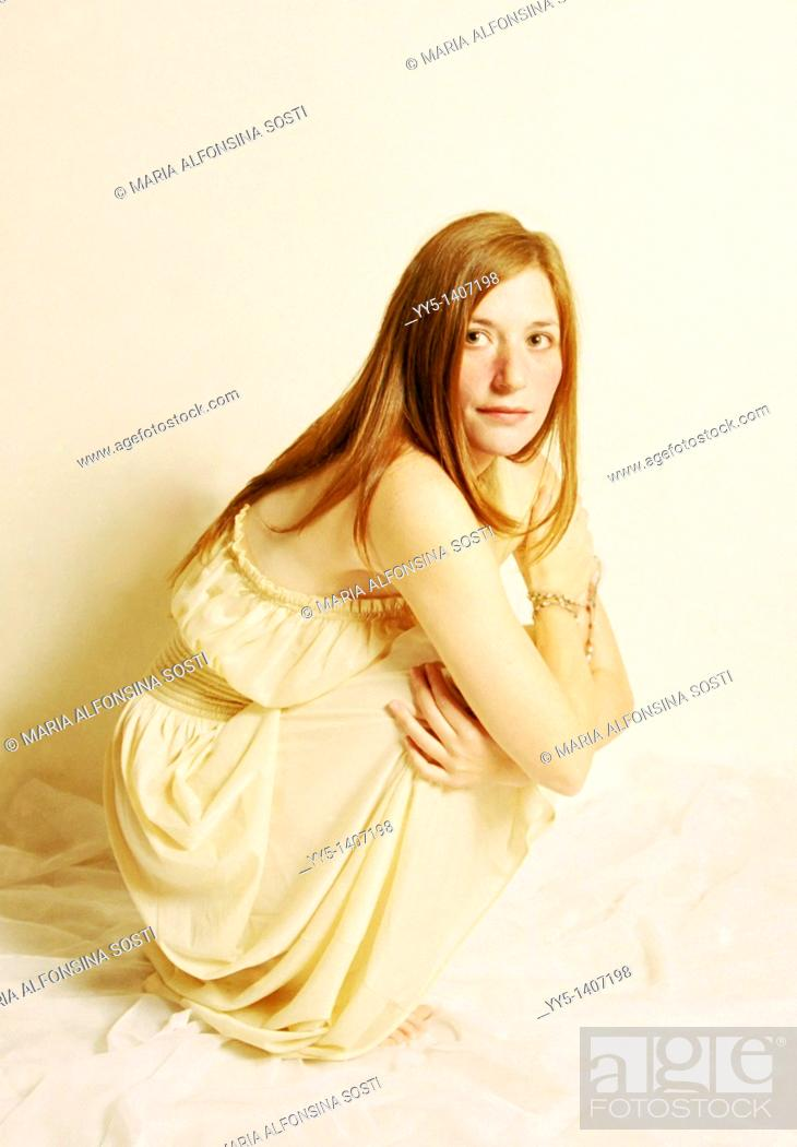 Stock Photo: Caucasian young woman with white dress.