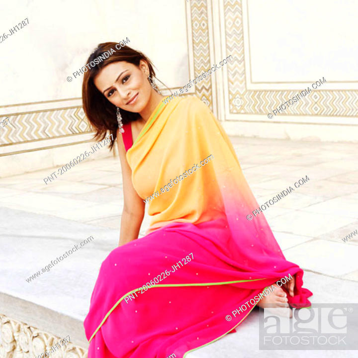 Stock Photo: Portrait of a young woman sitting in a mausoleum, Taj Mahal, Agra, Uttar Pradesh, India.