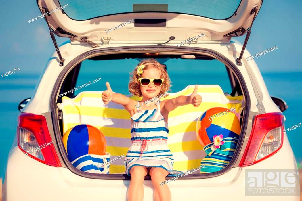 Stock Photo: Happy child travel by car. Kid having fun on the beach. Summer vacation concept.