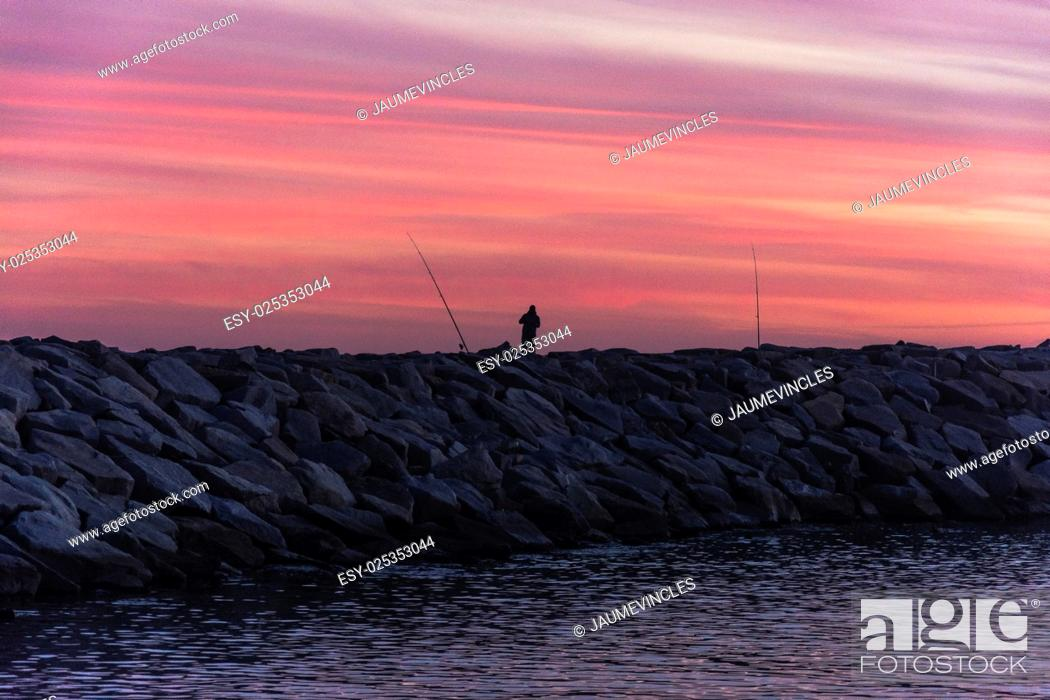 Stock Photo: Fishing in a quiet evening. Port Balis, Sant Andreu de Llavaneres, Maresme, Barcelona province, Spain.