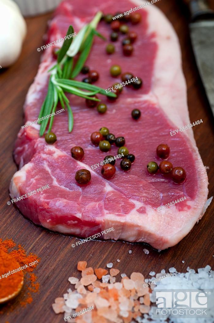 Stock Photo: raw uncooked ribeye beef steak butcher selection.