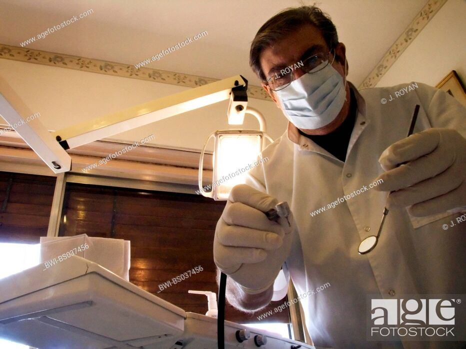 Stock Photo: Portrait of a dentist during the threatment.