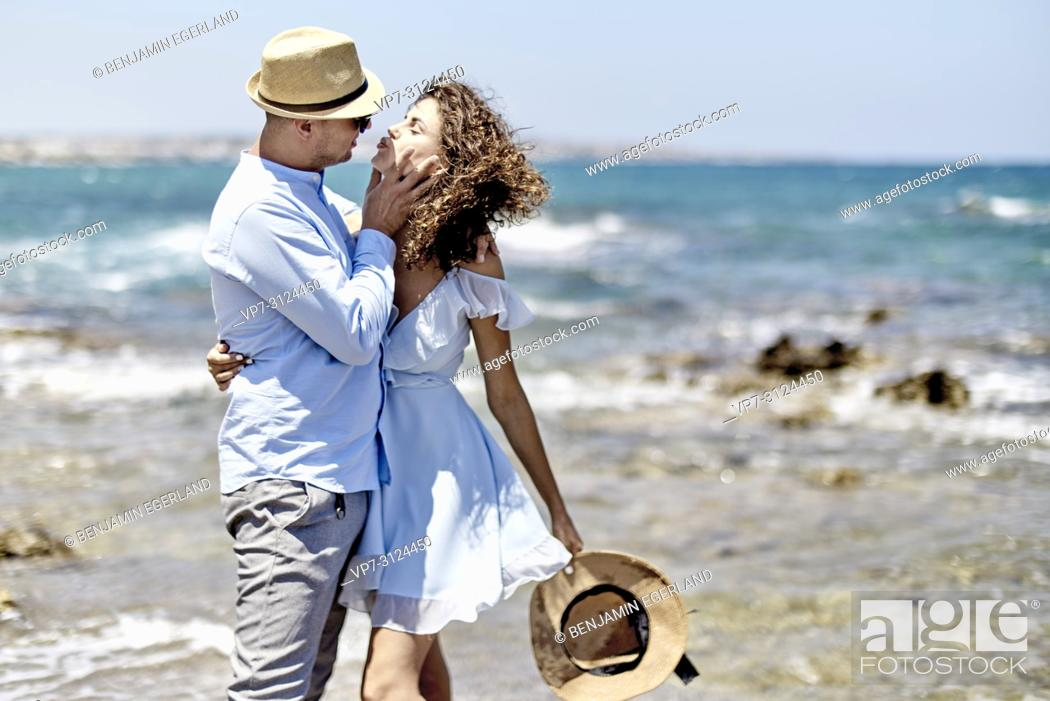 Stock Photo: couple at beach in Hersonissos, Crete, Greece.