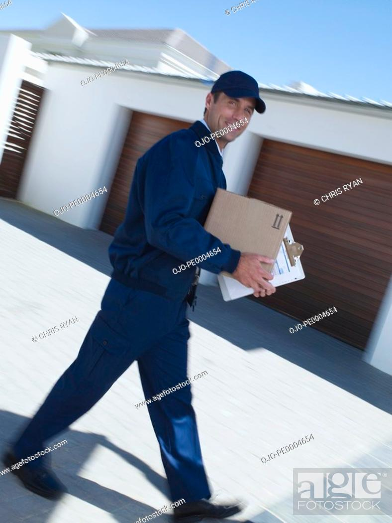 Stock Photo: Delivery person with package motion blur.
