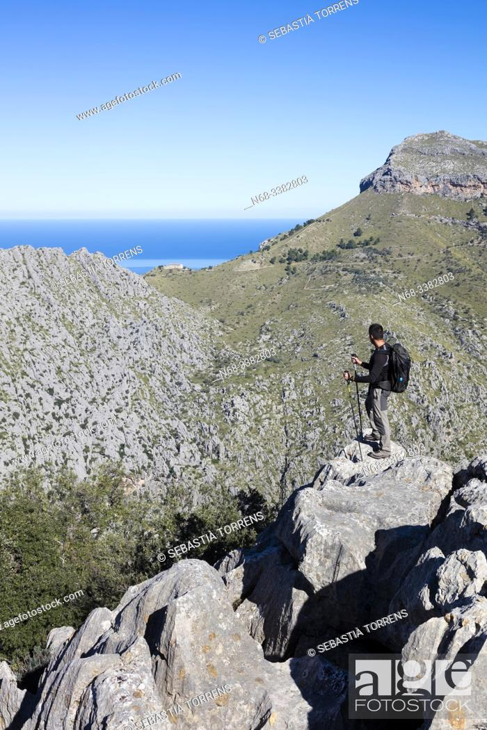 Stock Photo: Hiker in Serra de Tramuntana, Escorca, Mallorca, Spain.