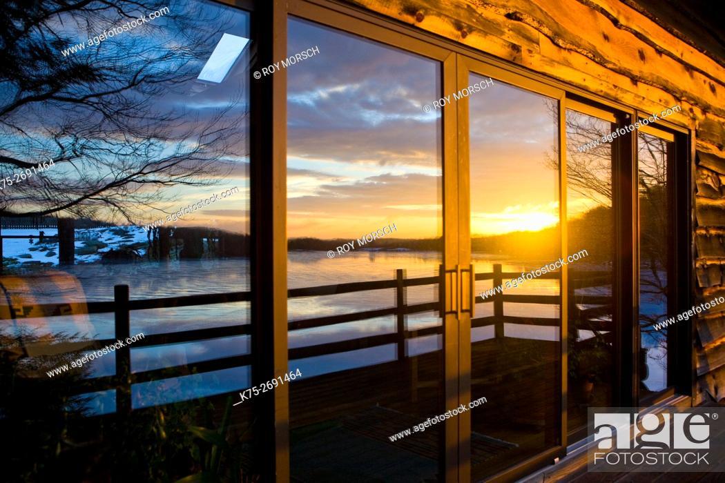 Stock Photo: Winter lake reflection on windows.