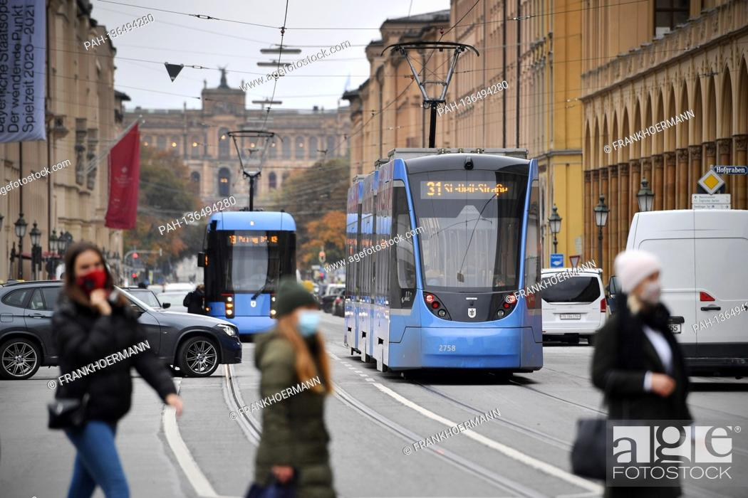 Stock Photo: Topic picture Mobility in big cities On Maximilianstrasse trams, trams, trams, cars, van pedestrians cross the wide street.
