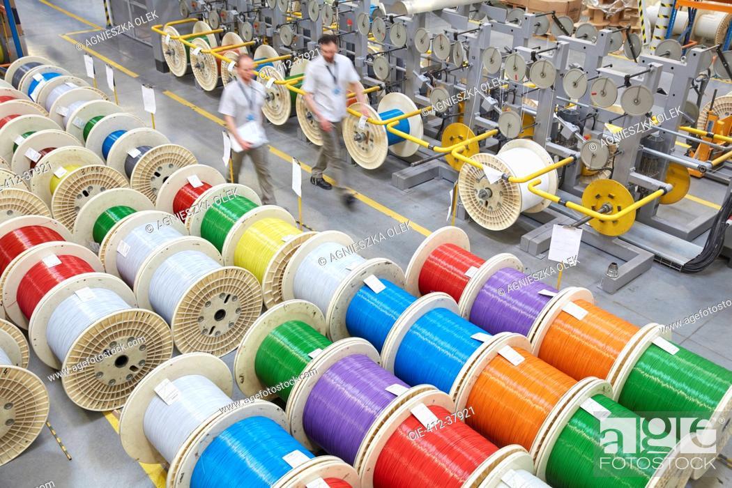 Photo de stock: Elevated view multicolor spools in fiber optics factory.