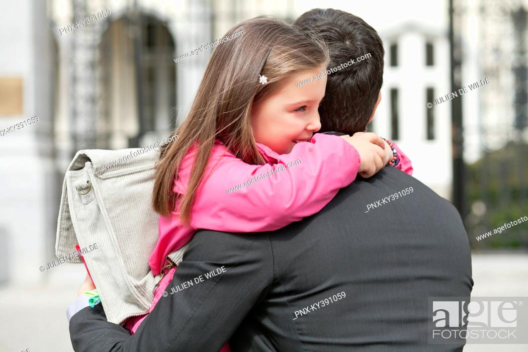 Stock Photo: Girl hugging her father.