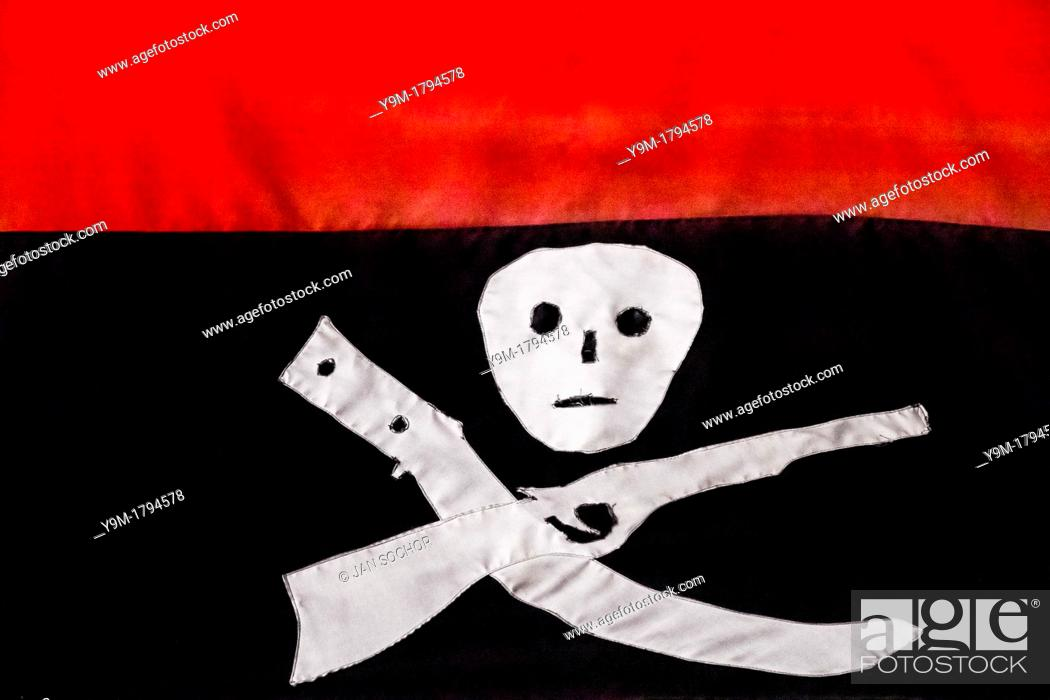 The Black And Red Flag Of The Fsln Having Symbols Of Death A Rifle