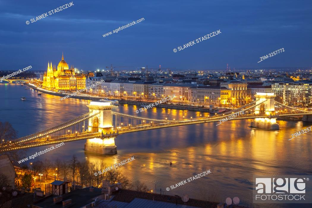 Stock Photo: Evening in Budapest, Hungary. Chain Bridge and Hungarian Parliament in the distance.