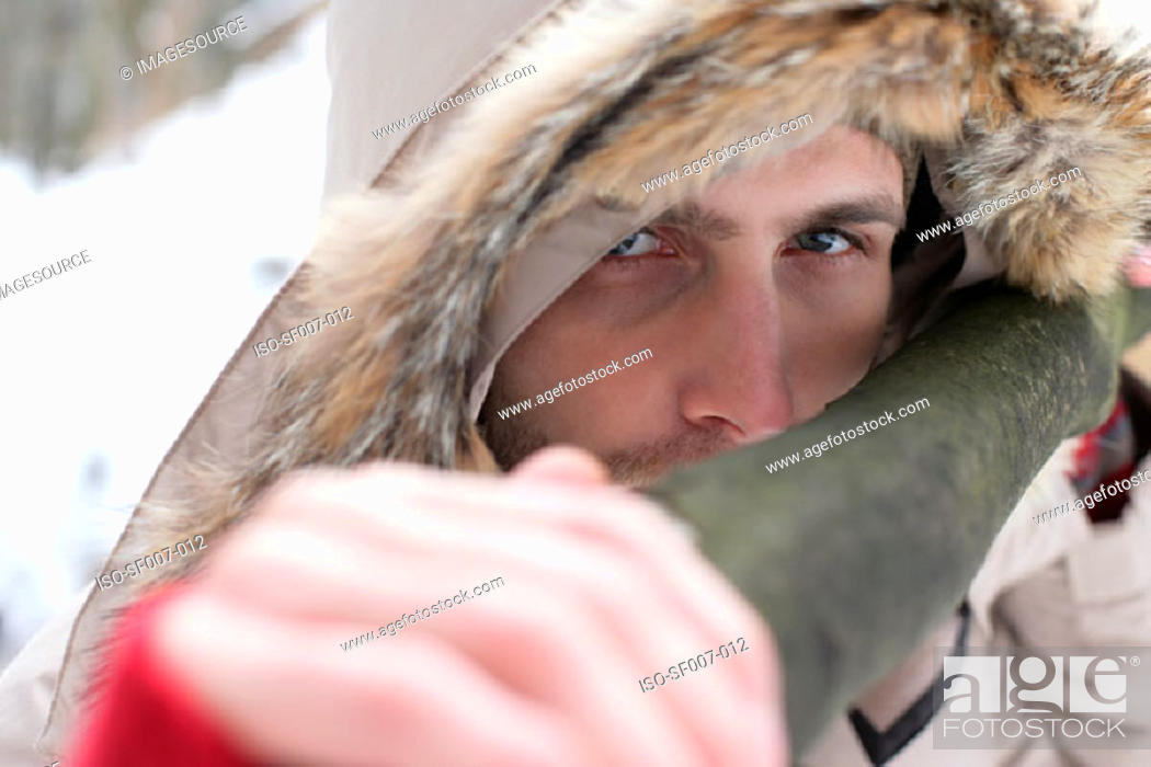 Stock Photo: Young man with a fur hood.