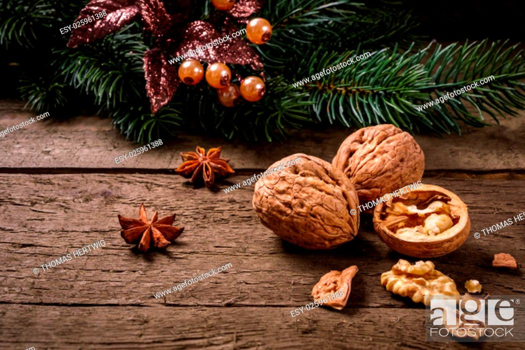 Stock Photo: Anise, fir branch, cranberries and walnuts on wooden planks. You can use it for christmas background, card or voucher.
