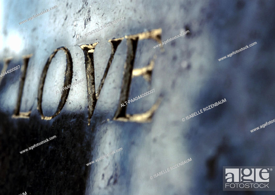 Stock Photo: 'Love' text embossed in gold.