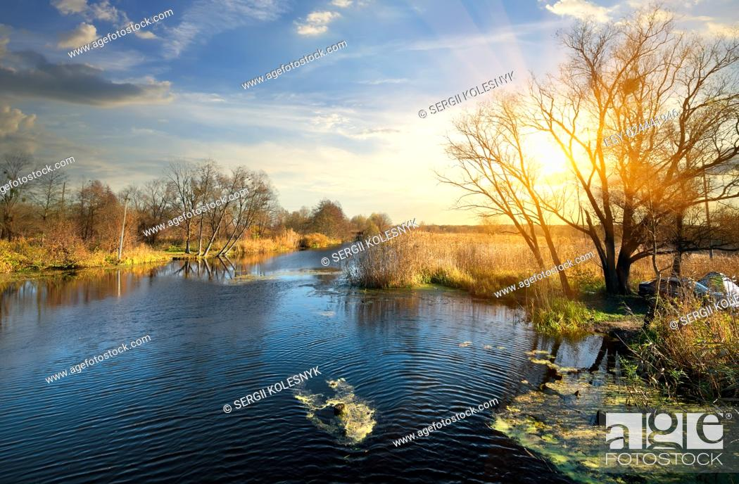 Stock Photo: Wonderful autumn on a river at sunrise.