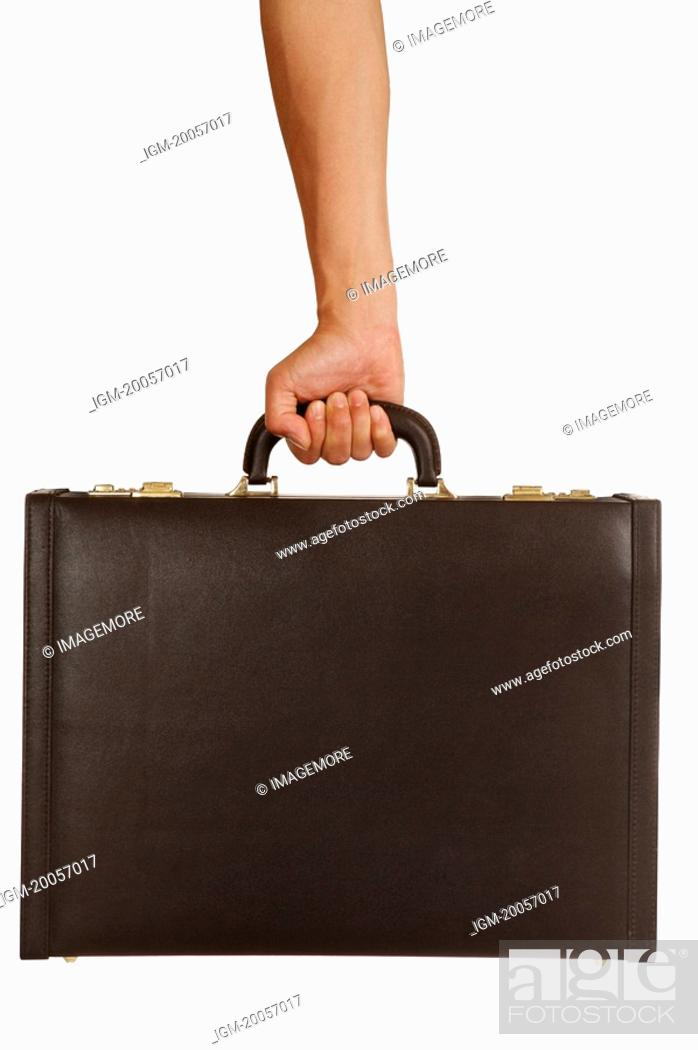 Stock Photo: Human hand holding a suitcase.