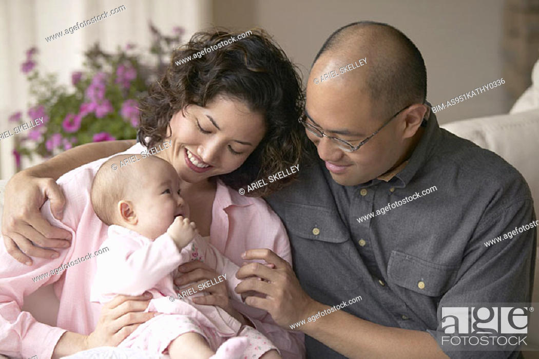 Stock Photo: Couple admiring their infant girl.