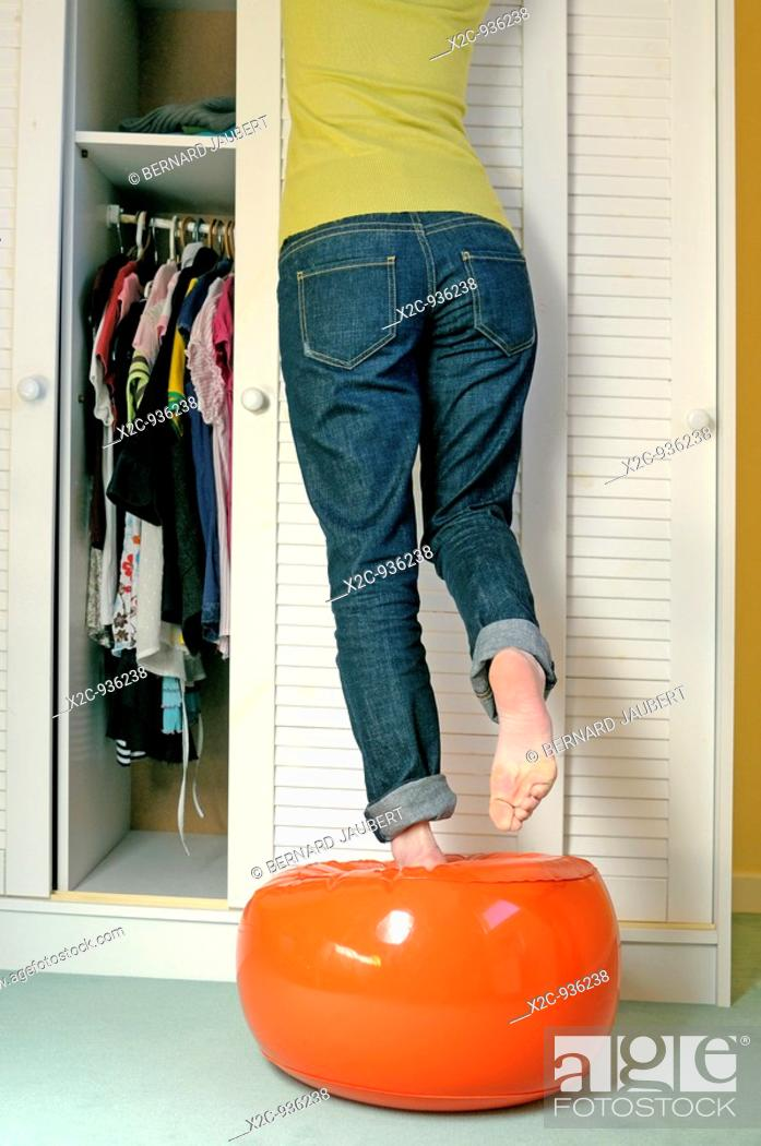 Stock Photo: girl doing putting away.
