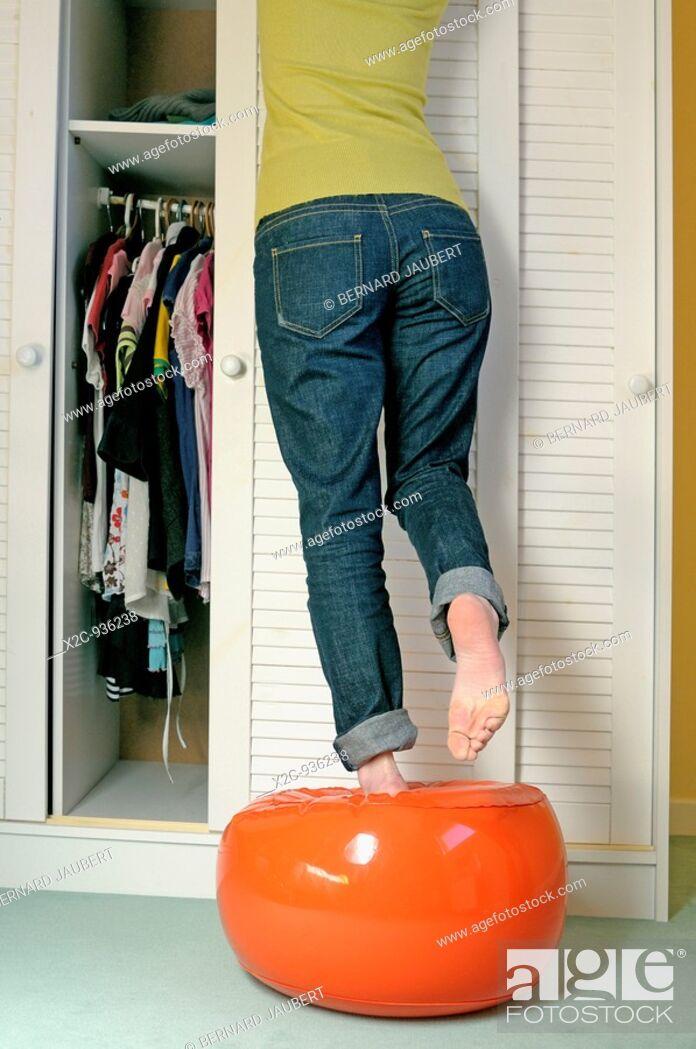 Stock Photo: girl doing putting away.