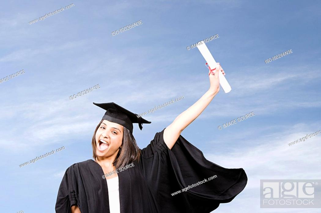 Stock Photo: Young woman graduating.
