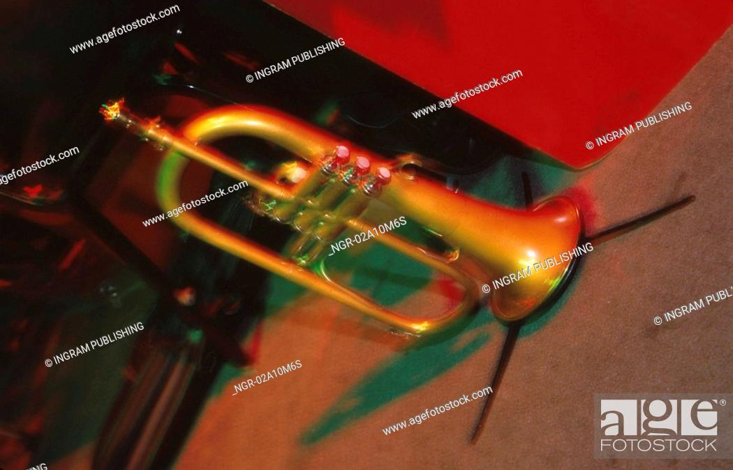 Stock Photo: Trumpet on Stand on Stage.