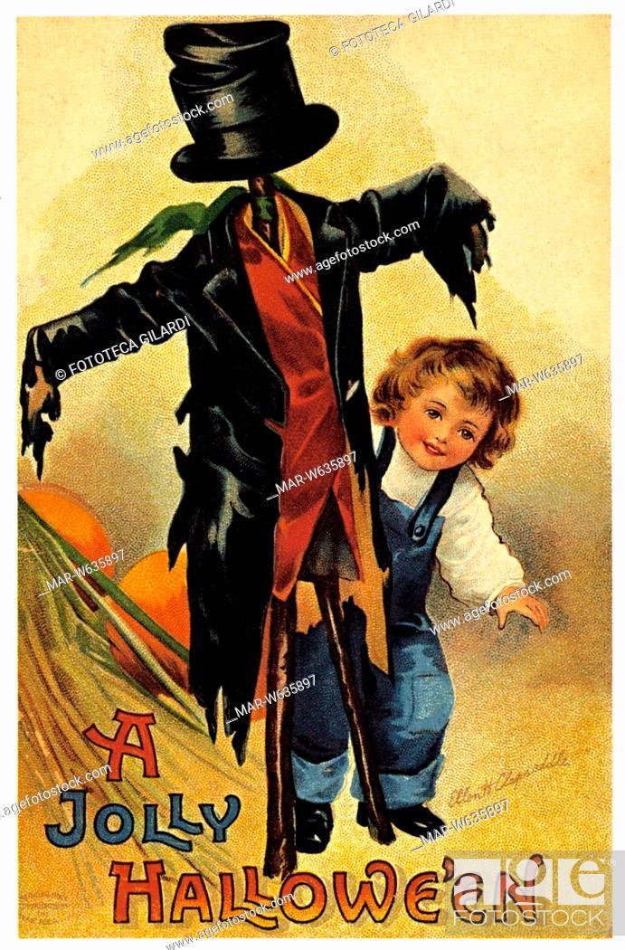 Stock Photo: HALLOWEEN 'A Jolly Hallowe'en' Vi sono raffigurati un bambino e uno spaventapasseri. Cartolina postale augurale per Halloween, primi anni del 1900.