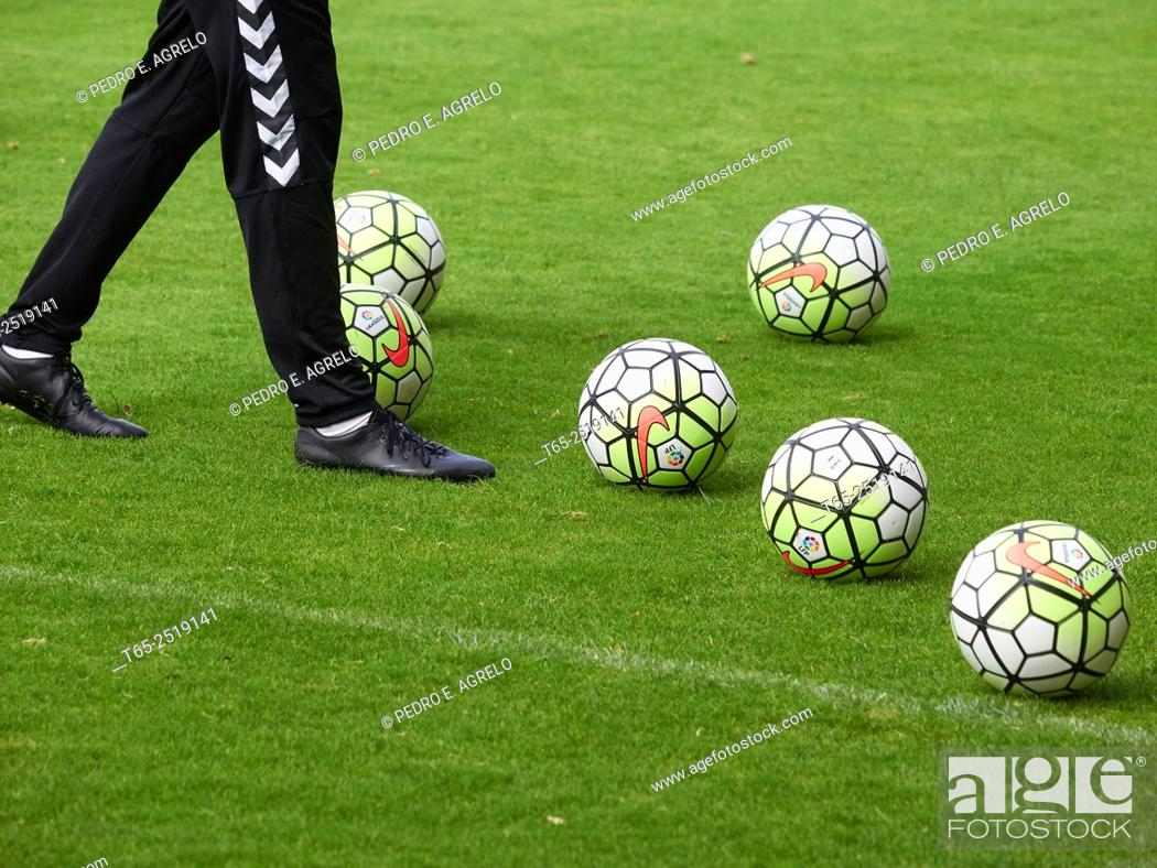 Stock Photo: Training Lugo.- second division CD Lugo in Anxo Carro with Luis Milla, image soccer ball on the grass field of the stadium.