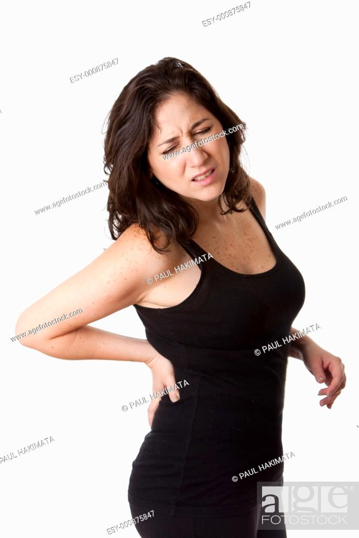 Stock Photo: Beautiful woman holding her back with pain and ache due to injury, wearing a sporty black tank top, isolated.