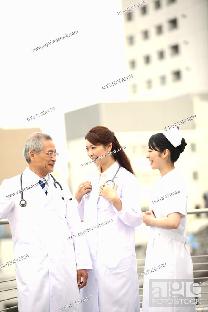 Stock Photo: Doctor and nurse having a chat.