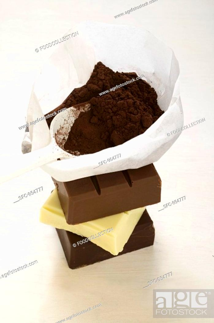 Stock Photo: Cocoa powder in bag with scoop on pieces of chocolate.