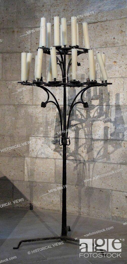 Imagen: Candelabra. Date: 15th century; Culture: European; Medium: Iron; Dimensions: Overall: 65 1/2 x 27 1/2 in. (166.4 x 69.9 cm); Classification: Metalwork-Iron;.