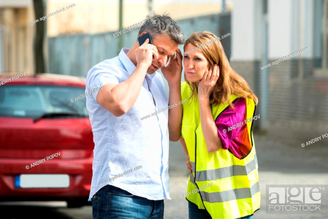 Stock Photo: Couple Calling For Service On Mobile Phone With Broken Down Car At Street.